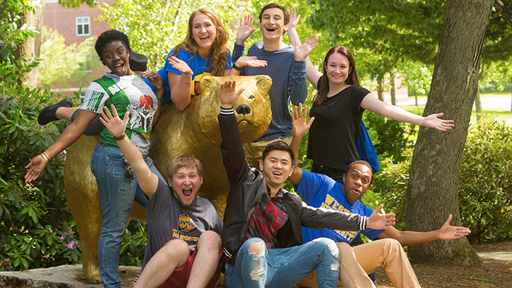 Students with golden bear statue.