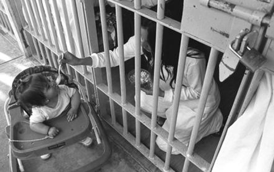Mother and baby in prison cell